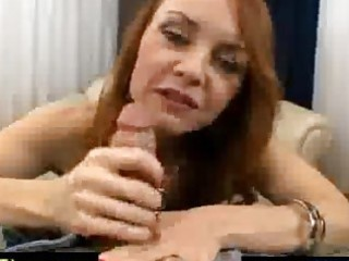 lewd red haired older spoiling a cock