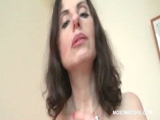 excited mature in pantyhose rubs twat and milk