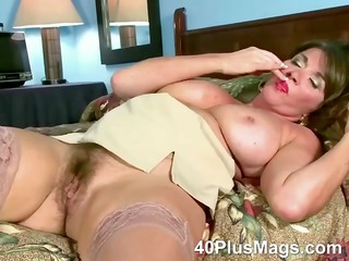 rubbing her ature hirsute pussy