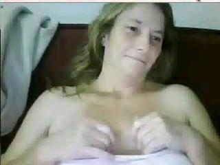busty mature brunette hair is on her livecam