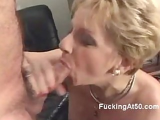 Horny blonde granny blows a cock and moans when