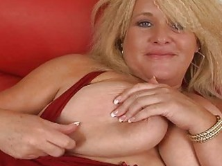 Huge blonde momma with massive bosom masturbates