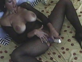 dark haired milf in body stocking masturbating