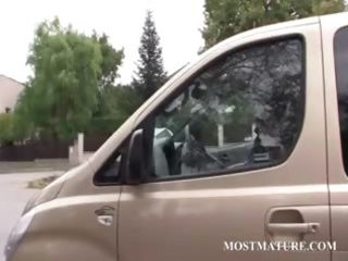 older sexy hitchhiker giving oral job to