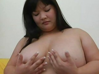 large asian momma with big meatballs plays with