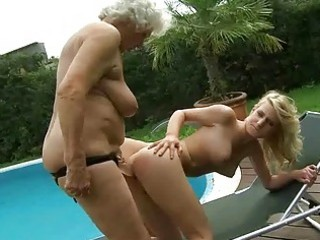breasty granny enjoys lesbian sex with legal age