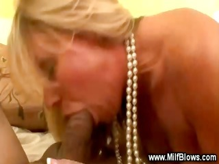 pleasing blonde cougar is engulfing a penis