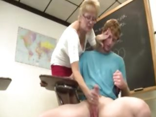 granny teacher tugs her students rod in the