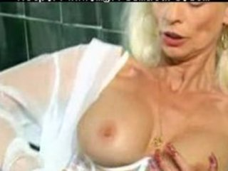 Mature in white lingerie and stockings fisted