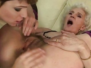 granny enjoys lesbo sex with young cutie