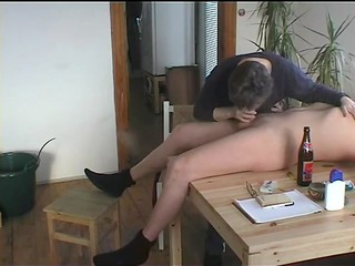 granny gives a oral-stimulation on the kitchen