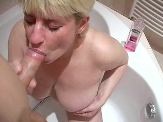 breasty older broad sucks a bulky dong