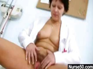 older brunette giving a self exam and using tool
