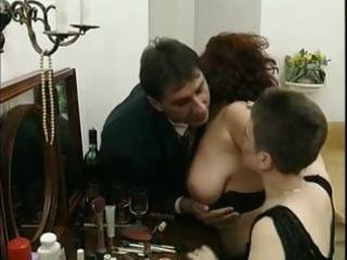 Horny busty mommy shares a massive cock with a