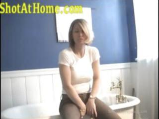 blonde mamma is posing and rubbing her twat on