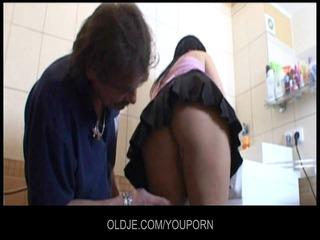 old repairman fix up a juvenile cum-hole