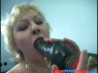 big-breasted older golden-haired bimbo does a