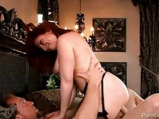 Busty redhead milf in stockings gets rammed hard