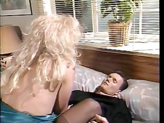 Skank in black stockings takes a huge white dick