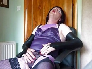 mature crossdresser in purple lingerie masturbates
