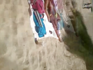 Mature beach voyeured topless (caught!)