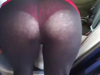 my wife cleaning the car in see thru leggings