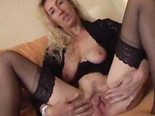nasty aged blond spreads her fur pie lips and