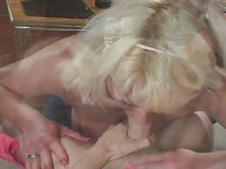 Blonde mature in white stocking fucks the boy