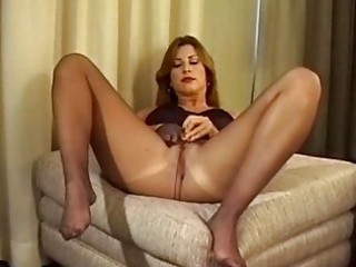 Milf spreads her legs and shows ass