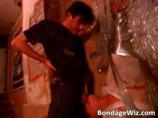 mature blond floozy is tied against part0