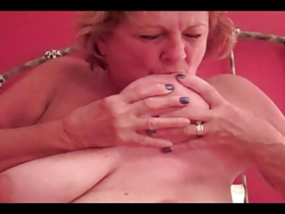huge tits granny sucks own nipples, blows