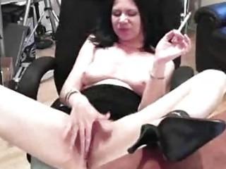 good looking older lady pleasures her wet muff