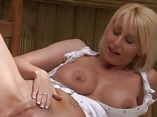 wicked blonde momma with big bosom in white