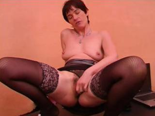 mature dame with short hair in dark nylons gives