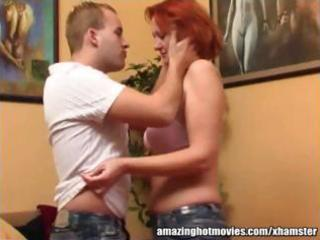 mature redhead getting her tits kissed and sucked