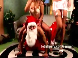 7 bawdy dominatrixes suffocate santa claus with