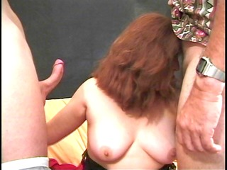 heavy-set aged woman shows she is can handle two!