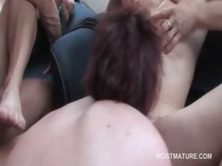 mature ambisextrous blond licking pussy in group