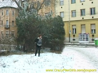 busty mama peeing in snow