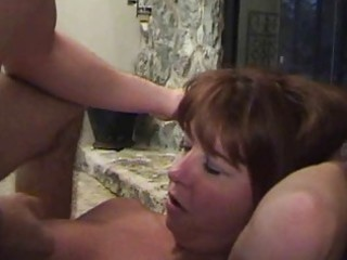 Busty redhead momma in black stockings gets