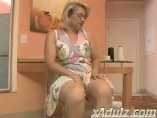 obese blond granny doing crochet gets excited and
