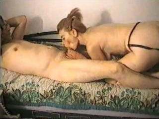 brunette hair wife is giving him a blowjob and