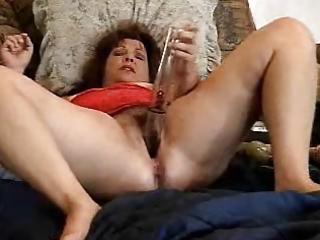 pervert older slut has enjoyment with her toys.
