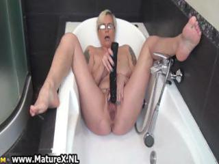 horny mature lady fucking her own taut