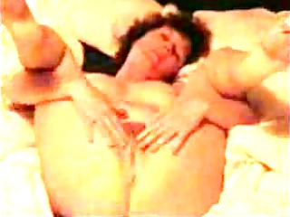 mature wife masturbates on the sofa