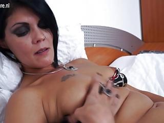 mature bitch mama masturbating on her bed