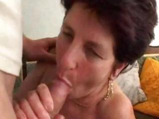 older brunette with a younger dude blows him and