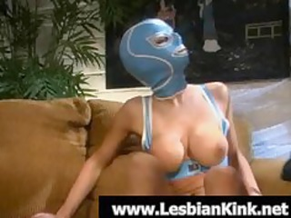 hot lesbo in rubber mask engulfing a biggest toy