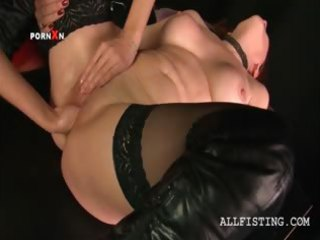 Lesbo mature in stockings gets fist fucked