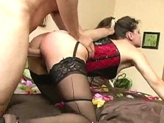 Milf in corset and stockings gets ridden hardcore